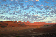 Damaraland was a name given to the north-central part of what later became Namibia, inhabited by the Damaras. It was bounded roughly by Ovamboland in the north, the Namib Desert in the west, the Kalahari Desert in the east, and Windhoek in the south.