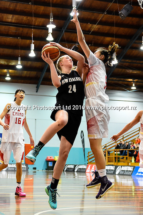 Charlotte Whittaker of the Junior Tall Ferns drives into Yijia Cao of China during the Internation Basketball match, Game 2, Junior Tall Ferns V China, Cowles Stadium, Christchurch, New Zealand. 8th Sept 2016. Copyright Photo: John Davidson / www.photosport.nz
