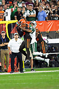 Cleveland Browns defensive back Terrance Mitchell (39) leaps and intercepts a late fourth quarter pass intended for New York Jets wide receiver Robby Anderson (11) that clinches the Browns first win since 2016 during the 2018 NFL regular season week 3 football game against the New York Jets on Thursday, Sept. 20, 2018 in Cleveland. The Browns won the game 21-17. (©Paul Anthony Spinelli)