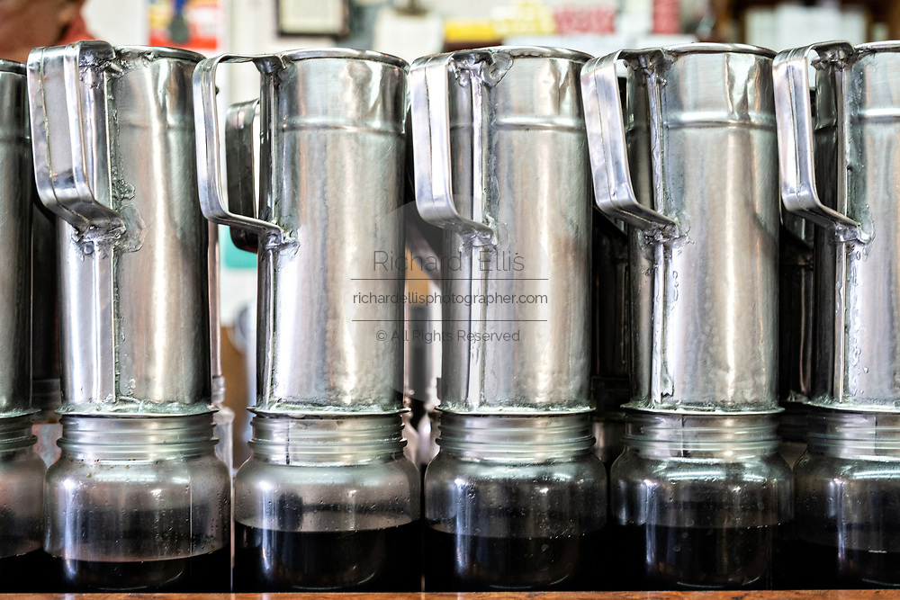 A stack of stainless steel cold brew drip coffee pots in Atotonilco de Alto, Mexico.