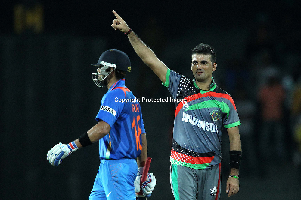 Dalwat Zadran celebrates the wicket of Virat Kholi as he departs during the ICC World Twenty20 match between India and Afghanistan held at the Premadasa Stadium in Colombo, Sri Lanka on the 19th September 2012<br /> <br /> Photo by Ron Gaunt/SPORTZPICS