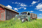 Old International truck and wodden grainery on farm<br /> Hazenmore<br /> Saskatchewan<br /> Canada