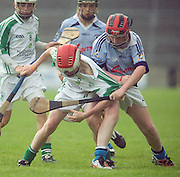 Jack Lawlor a O'loughlin Gaels pulled by Jason Callinan Na Piarsaigh in the Division 1 Final at Pearse Stadium in the Féile na nGael 2011. Photo:Andrew Downes.