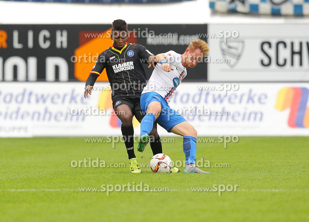 27.09.2015, Voith Arena, Heidenheim, GER, 2. FBL, 1. FC Heidenheim vs Karlsruher SC, 9. Runde, im Bild Boubacar Barry ( Karlsruher SC ) rechts Marc Schnatterer (1.FC Heidenheim) // during the 2nd German Bundesliga 9th round match between 1. FC Heidenheim and Karlsruher SC at the Voith Arena in Heidenheim, Germany on 2015/09/27. EXPA Pictures &copy; 2015, PhotoCredit: EXPA/ Eibner-Pressefoto/ Langer<br /> <br /> *****ATTENTION - OUT of GER*****
