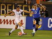 CHATTANOOGA, TN - AUGUST 19:  Midfielder Wendy Acosta #20 of Costa Rica is challenged for the ball by Alex Morgan #13 of the United States during the friendly match at Finley Stadium on August 19, 2015 in Chattanooga, Tennessee.  (Photo by Mike Zarrilli/Getty Images)