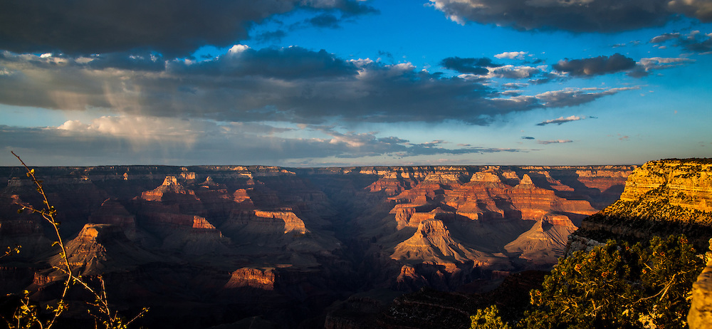 The Sun sets on the Grand Canyon casting some rare light. Photos of the Grand Canyon