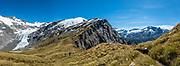 Panorama of Cascade Saddle in Mount Aspiring National Park, Otago region, South Island of New Zealand. At left is the Dart Glacier. At center is Reid Glacier on Plunket Dome (2191m). At center right is Mt Aspiring above the Matukituki Valley. Cascade Saddle is a spectacular 20-kilometer side trip from Dart Hut on the Rees-Dart Track. This image was stitched from multiple overlapping photos.
