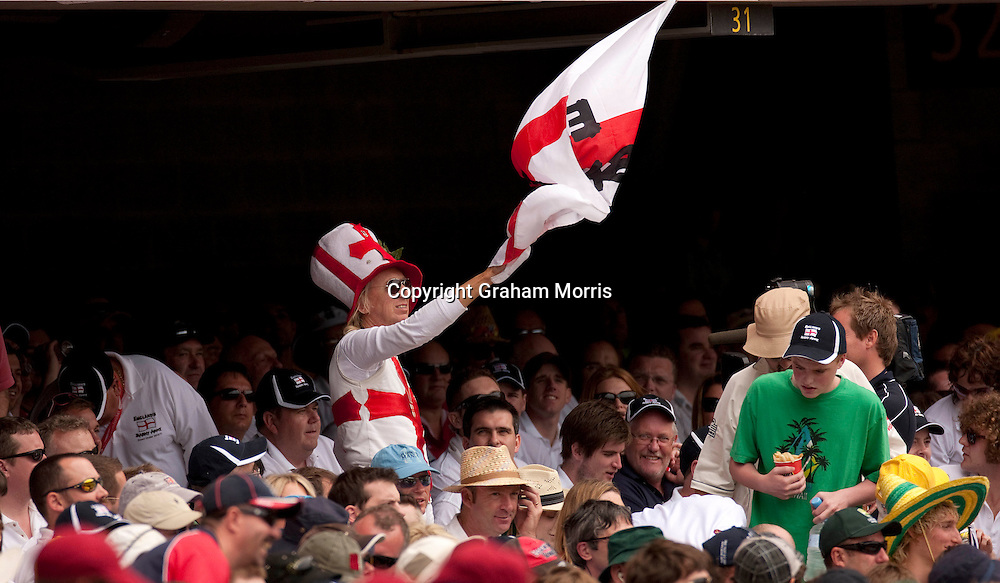 The Barmy Army's flag-waving Vic Flowers tries to whip up some support during the first Ashes Test Match between Australia and England at the Gabba, Brisbane. Photo: Graham Morris (Tel: +44(0)20 8969 4192 Email: sales@cricketpix.com) 25/11/10