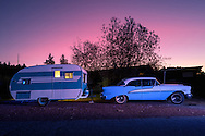 USA, Oregon, Redmond, classic car and trailer at dusk