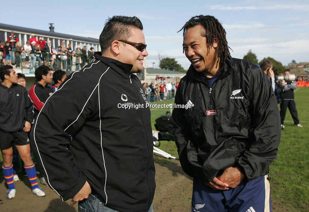 Warriors coach Tony Kemp talks to Tana Umaga during the All Blacks training session at Silverdale United RFC, North of Auckland, New Zealand, Wednesday 7th July 2004. The All Blacks play the Pacific Islanders on Saturday.<br />PHOTO: Andrew Cornaga/PHOTOSPORT