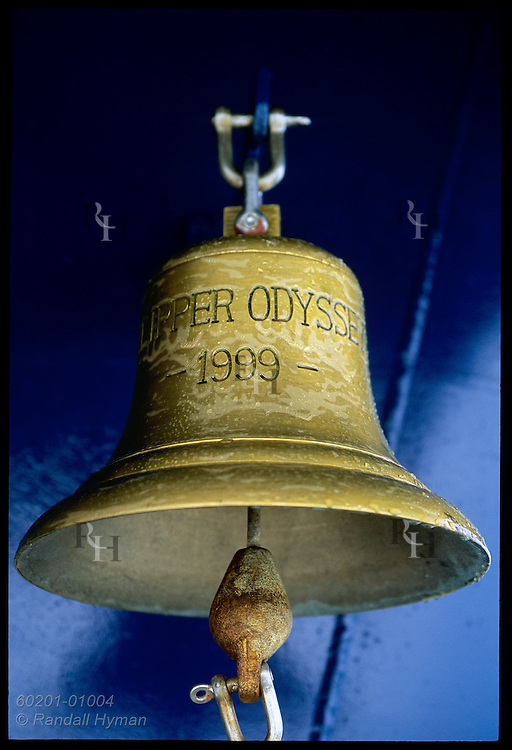 Bell of the cruise ship Clipper Odyssey, built 1999, hangs outside the bridge after a soaking in a South Pacific storm; New Zealand.