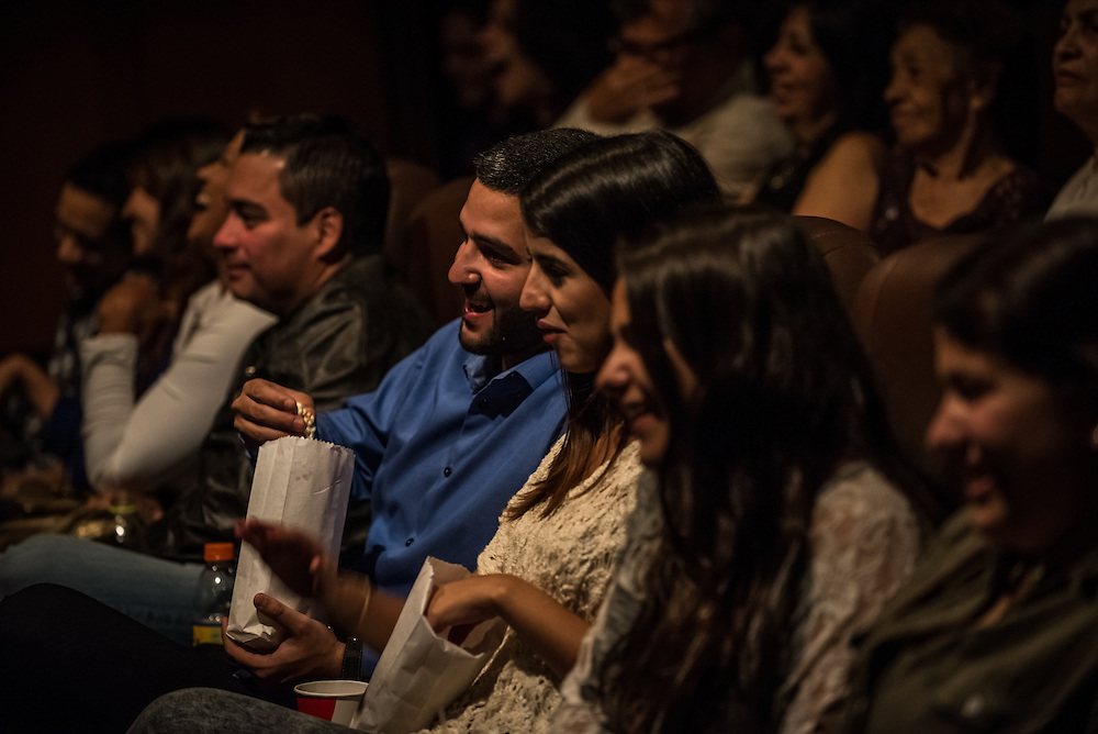 "CARACAS, VENEZUELA - MAY 9, 2015:  Members of the audience laugh while attending the  ""Malas Ideas"" stand-up comedy show outside of Caracas, Venezuela.  PHOTO: Meridith Kohut for Buzzfeed News"