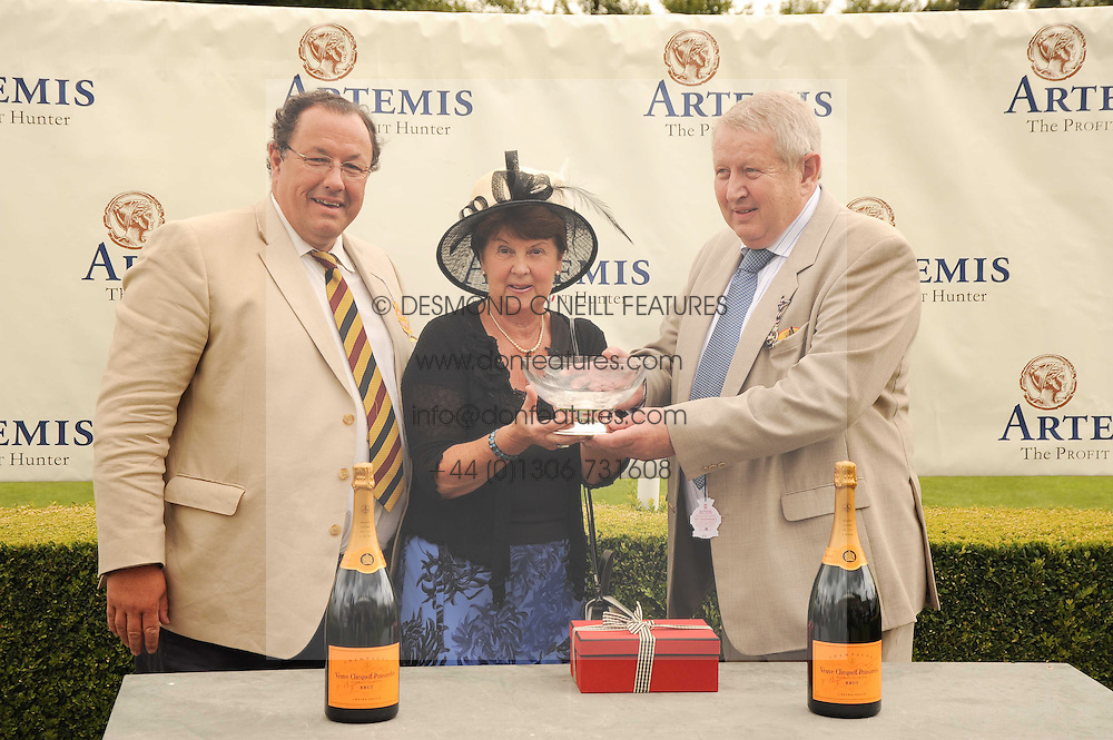 Left to right, RICHARD TURPIN MD of Artemis and IAN & PAM BENDELOW owners of Illustrious Blue winner of the Artemis Goodwood Cup at the third day of the 2010 Glorious Goodwood racing festival at Goodwood Racecourse, Chichester, West Sussex on 29th July 2010.