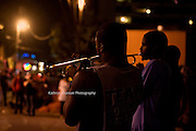 Street Jazz Musicians playing at night in the French Quarter in New Orleans, Lousiana