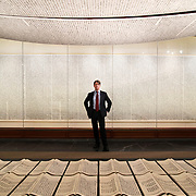 """March 3, 2014 - New York, NY : Thomas Campbell, director of the Metropolitan Museum of Art, poses for a portrait at the museum on Monday morning with 徐冰 天书 Xu Bing's """"Book from the Sky,"""" ca. 1987–91, an installation of hand-printed books and ceiling and wall scrolls printed from wood letterpress type. The work is on display as part of the exhibit """"Ink Art: Past as Present in Contemporary China."""" CREDIT: Karsten Moran for The New York Times"""