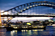Sydney Sites travel series. A Sydney Harbor ferry at sunset with the harbour bridge.