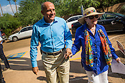 29 AUGUST 2012 - PARADISE VALLEY, AZ:   Dr. RICHARD CARMONA, Democratic candidate for US Senate from Arizona, and JOANNE GOLDWATER walk into Barry Goldwater Memorial Park in Paradise Valley, AZ for a press conference Wednesday. Carmona won the endorsements of Joanne Goldwater, daughter of Barry Goldwater, the late legendary Republican Senator from Arizona. He was also endorsed by CC Goldwater, her daughter, and Tyler Ross Goldwater, CC Goldwater's son. Barry Goldwater was from Paradise Valley.  PHOTO BY JACK KURTZ