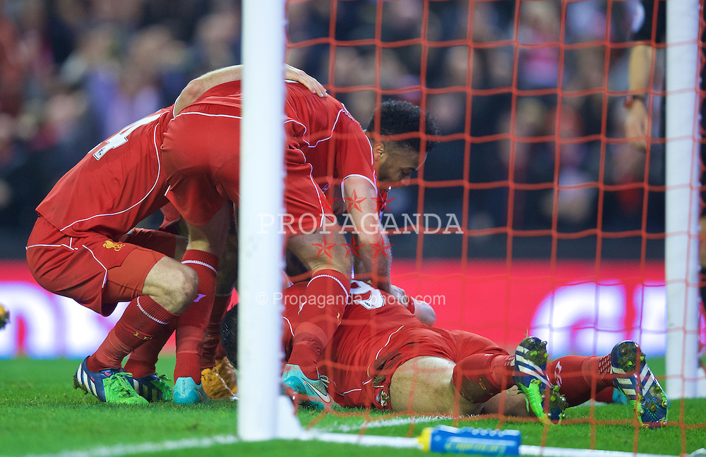 LIVERPOOL, ENGLAND - Saturday, November 29, 2014: Liverpool players celebrate with goal-scorer Glen Johnson during the Premier League match against Stoke City at Anfield. (Pic by David Rawcliffe/Propaganda)