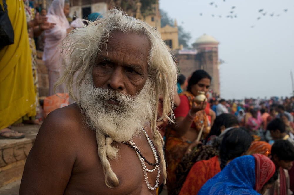 In this photograph a Hindu holy man mingles among other pilgrims during a festival in Varanasi, India