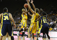 26 JANUARY 2009: Iowa guard Kachine Alexander (21) puts up a shot during the first half of an NCAA women's college basketball game Monday, Jan. 26, 2009, at Carver-Hawkeye Arena in Iowa City, Iowa. Iowa defeated Michigan 77-69.
