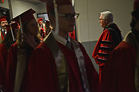 Chancellor Randy Woodson congratulates graduates as they file into PNC Arena.