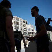 August 10, 2012 - Aleppo, Syria: A group of Free Syria Army (FSA) fighters advance towards the frontline in Saheledine, a strategic neighborhood in southwest Aleppo...The Syrian Army have in the past week increased their attacks on residential neighborhoods where Free Syria Army rebel fights have their positions in Syria's commercial capital, Aleppo. (Paulo Nunes dos Santos/Polaris)