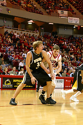 08 January 06  Kyle Wilson get a foot in on Michael Vandello during a free throw.....The Illinois State Redbirds come up short against the Witchita State Shockers.  The Shockers put on a 2nd half show that left the Redbirds trailing 56 - 47 at the bell.  Dana Ford of the Redbirds matched his career high with 16 points, adding 7 boards and 4 steals.....Redbird Arena, Illinois State University  campus, Normal, Illinois