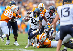 Sep 1, 2018; Charlotte, NC, USA; West Virginia Mountaineers running back Martell Pettaway (32) runs the ball during the first quarter against the Tennessee Volunteers at Bank of America Stadium. Mandatory Credit: Ben Queen-USA TODAY Sports
