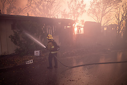 October 28, 2019, Los Angeles, California, USA: Firefighters put water on a burning home along Trailridge in Los Angeles in the Getty fire. (Credit Image: © David Crane/Orange County Register via ZUMA Wire)