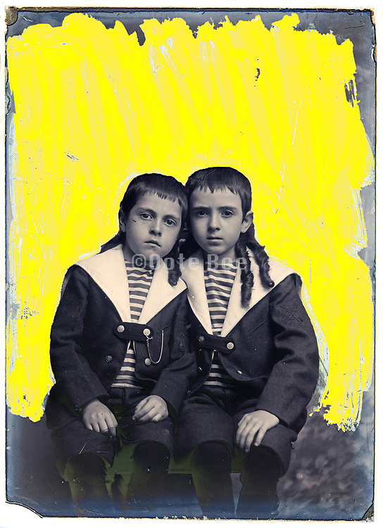 vintage studio portrait of two boys with strong yellow background retouching markings on the glass plate