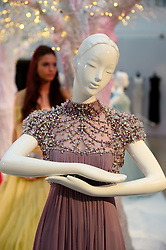 Pictured is the 'Rapunzel' dress from Tangled designed by Jenny Packham.<br /> Unique designer dresses inspired by Disney's Iconic Princesses to go under the hammer in aid of Great Ormond Street Hospital at Christie's South Kensington, London, United Kingdom. Friday, 8th November 2013. Picture by Ben Stevens / i-Images