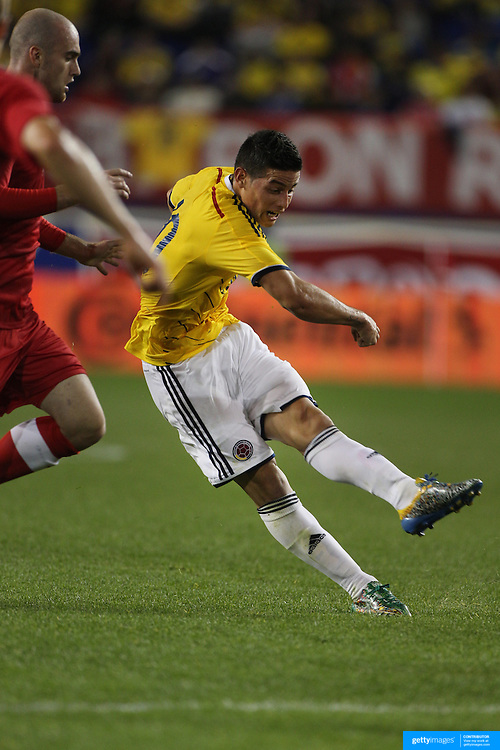 James Rodriguez, Colombia, shoots to score the winning goal during the Colombia Vs Canada friendly international football match at Red Bull Arena, Harrison, New Jersey. USA. 14th October 2014. Photo Tim Clayton
