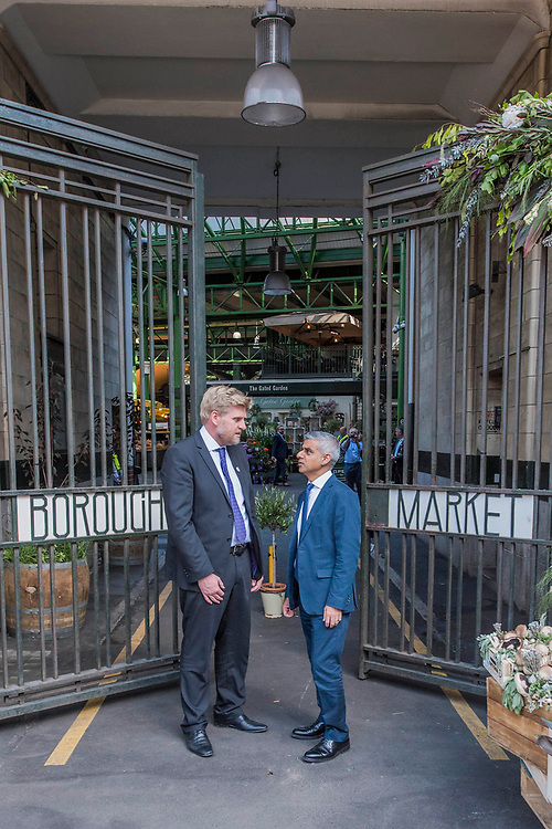 The Mayor Sadiq Khan arrives and is greeted by market officials at teh main gate - The market reopening is signified by the ringing of the bell and is attended by Mayor Sadiq Khan. Tourists and locals soon flood back to bring the area back to life.