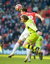 LONDON, ENGLAND - Saturday, January 30, 2010: Charlton Athletic's Grant Basey and Tranmere Rovers' Ian Moore battle in the air during the Football League One match at the Valley. (Photo by Gareth Davies/Propaganda)