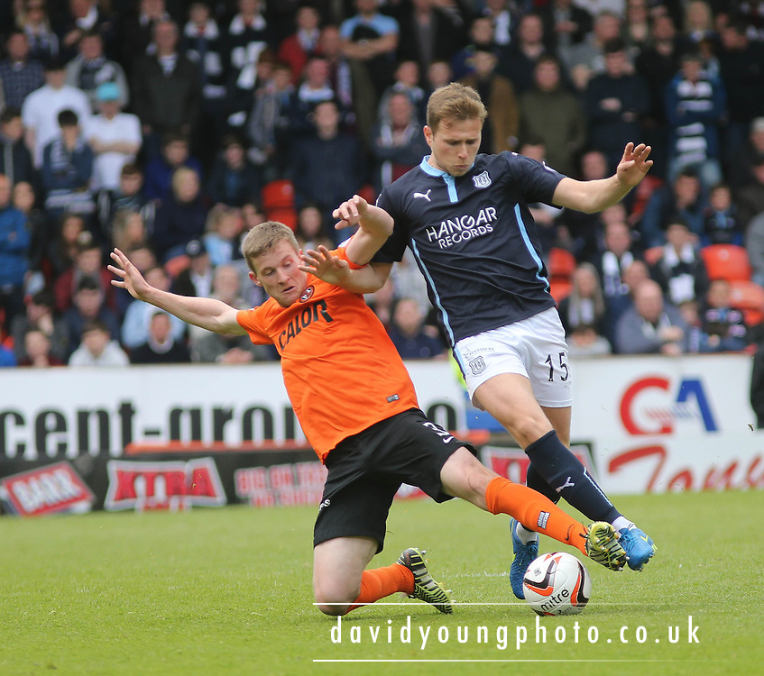 Dundee United's Paul Dixon tackles Dundee's Greg Stewart - Dundee United v Dundee at Tannadice Park in the SPFL Premiership<br /> <br />  - &copy; David Young - www.davidyoungphoto.co.uk - email: davidyoungphoto@gmail.com