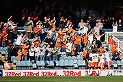 Blackpool forward Nathan Delfouneso (7) celebrates his goal with teammates in front of the Blackpool fans during the EFL Sky Bet League 1 match between Peterborough United and Blackpool at The Abax Stadium, Peterborough, England on 29 September 2018.
