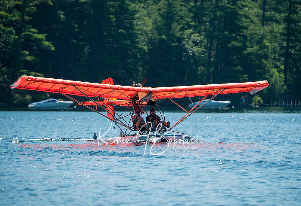 Pamela and Keith Markley taxi out from Center Harbor Bay preparing for takeoff in their Quicksilver Seaplane on Friday morning.  (Karen Bobotas/for the Laconia Daily Sun)