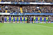 Both sets of players stand together while the French National anthem is played before the Barclays Premier League match at Stamford Bridge, London<br /> Picture by Paul Chesterton/Focus Images Ltd +44 7904 640267<br /> 21/11/2015