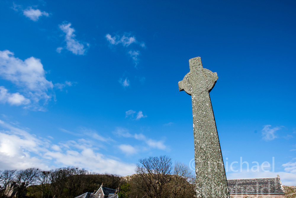 One of the many crosses on the way to Iona Abbey..Iona is a small island in the Inner Hebrides off the western coast of Scotland. It was a centre of Irish monasticism for four centuries and is today renowned for its tranquility and natural beauty..©Michael Schofield..