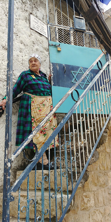 Margalit Zinati was born in 1931 in Kfar Peki'in in the Galilee. She is part of an ancient Jewish family that has been preserving the Jewish community in the Galilee continuously since the days of the Second Temple.<br /> Margalit Zinati was chosen as one of the 14 torch lighters on Israel's 2018 Independence Day ceremony