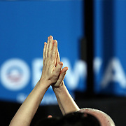 Supporters clap as President Barack Obama speaks during his Grassroots event at the Kissimmee Civic Center in Kissimmee, Florida on Saturday, September 8, 2012. (AP Photo/Alex Menendez)