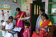 A health worker, centre left, uses a tablet device following an immunisation of a child at an Aanganwadi, a government family health centre in Rangsaipet, in Waragal, Telangana, Indiia, on Saturday, February 9, 2019. Photographer: Suzanne Lee for Safe Water Network
