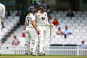 Ollie Robinson of Kent and Grant Stewart of Kent celebrate at the end of the game during the Specsavers County Champ Div 1 match between Surrey County Cricket Club and Kent County Cricket Club at the Kia Oval, Kennington, United Kingdom on 10 July 2019.