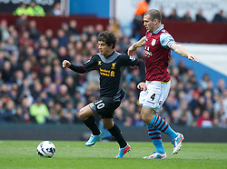 BIRMINGHAM, ENGLAND - Easter Sunday, March 31, 2013: Liverpool's Philippe Coutinho Correia in action against Aston Villa's Ron Vlaar during the Premiership match at Villa Park. (Pic by David Rawcliffe/Propaganda)