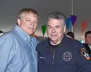 East Meadow, New York, U.S. March 31, 2012. L-R. RAY PFEIFER and Congressman PETE KING (Republican - NY02) pause chat to pose for photo at fundraiser for Pfeifer, an FDNY firefighter battling cancer after months of recovery efforts at Ground Zero following 9/11 2001 Twin Towers attack. Benefit was held at East Meadow Firefighters Benevolent Hall.