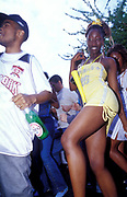 A cute girl dancing in the street, Notting Hill Carnival, UK 2003