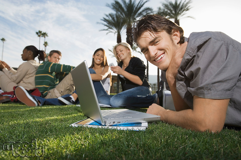 College Students Studying in the Grass