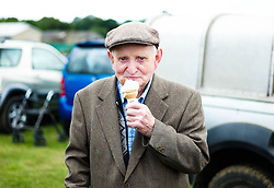 © Licensed to London News Pictures.29/07/15<br /> Borrowby, UK. <br /> <br /> A man eats an ice cream as he visits the Borrowby Country Show and Gymkhana in North Yorkshire.<br /> <br /> Photo credit : Ian Forsyth/LNP