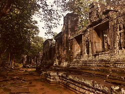 April 28, 2018 - Siem Reap, Siem Reap, China - Angkor Wat is a temple complex in Cambodia and the largest religious monument in the world, on a site measuring 162.6 hectares (1,626,000 m2; 402 acres).It was originally constructed as a Hindu temple of god Vishnu for the Khmer Empire, gradually transforming into a Buddhist temple towards the end of the 12th century.It was built by the Khmer King Suryavarman II in the early 12th century in Ya odharapura, the capital of the Khmer Empire, as his state temple and eventual mausoleum. Breaking from the Shaiva tradition of previous kings, Angkor Wat was instead dedicated to Vishnu. As the best-preserved temple at the site, it is the only one to have remained a significant religious centre since its foundation. The temple is at the top of the high classical style of Khmer architecture. It has become a symbol of Cambodia,appearing on its national flag, and it is the country's prime attraction for visitors. (Credit Image: © SIPA Asia via ZUMA Wire)
