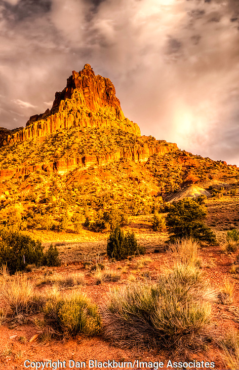 The landmark rock formation The Castle towers over Capitol Reef National Park in Utah at Sunset